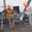Builders pouring concrete into form — Stock Photo