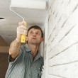 Painter worker painting a ceiling — Stock Photo #3244393