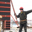 Stock Photo: Worker builder and concrete formwork