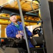 Forklift worker at warehouse — Stock Photo