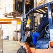 Warehouse forklift loader work — Stock fotografie