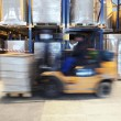 Forklift in motion at warehouse — Stock Photo