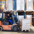 Warehouse work with forklift loader — Stock Photo
