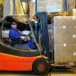 Forklift loader worker at warehouse — Stock Photo