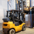 Forklift loader stacking in warehouse — Stock Photo #3245039