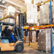 Warehouse forklift loader worker - Stock Photo