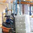Forklift loader at a warehouse — Stock Photo