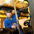 Forklift loader worker at warehouse — Stock Photo #3245097