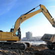 Loader excavator loading rear-end tipper — Stock Photo #3245385