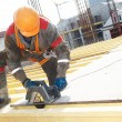 Builder making construction works - Foto Stock
