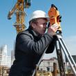 Stock Photo: Surveyor with transit level equipment