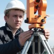 Surveyor with transit level equipment — Stock Photo #3245853
