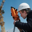 Surveyor with transit level equipment — Stock Photo #3245860