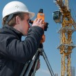 Surveyor with transit level equipment — Stock Photo #3245862