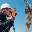 Surveyor with transit level equipment - Zdjcie stockowe