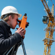Surveyor with transit level equipment - Foto Stock