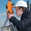 Surveyor with transit level equipment — Stock Photo #3245888
