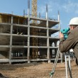 Surveyor with transit level equipment - Stockfoto