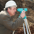Surveyor at construction work — Stock Photo
