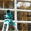 Theodolite at construction site — Stockfoto