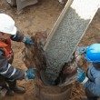 Two workers at piling — Stock Photo