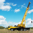 Mobile crane with risen boom outdoors — Стоковая фотография