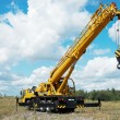 Mobile crane with risen boom outdoors — Stock Photo #3246104