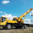 Mobile crane with risen boom outdoors — Stock Photo #3246110