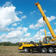 Stock Photo: Mobile crane with risen boom outdoors