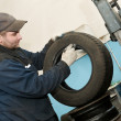 Stock Photo: Repairmlubricating car tyre