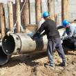 Stock Photo: Builders with equipment for piling