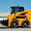 Skid steer loader construction machine - Stock Photo