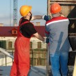 Workers builders at construction site — Stockfoto