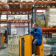Order picker loader in warehouse - Zdjęcie stockowe