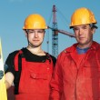 Builders at construction site — Stockfoto