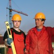 Foto Stock: Builders workers at construction site