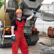 Stockfoto: Construction builder and concrete mixer