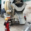 Foto Stock: Construction builder and concrete mixer