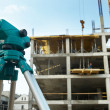 Theodolite at construction site - Stock Photo