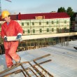 Two builders at construction site — Stockfoto