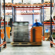 Warehouse truck works - Stock Photo
