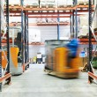 Stock Photo: Warehouse truck loader works