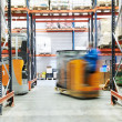 Warehouse truck loader works - Stock Photo