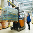 Distribution in warehouse with forklift - Stock Photo