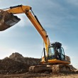 Excavator loader in construction sandpit area — Stock Photo