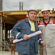 Stock Photo: Engineers builders at construction site