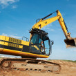 Stock Photo: Loader excavator moving in a quarry