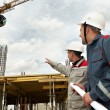 Engineers builders at construction site — Stock Photo #3247737