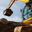 Stock Photo: Loader excavator works in a quarry
