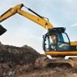 Loader excavator in a quarry - Stockfoto